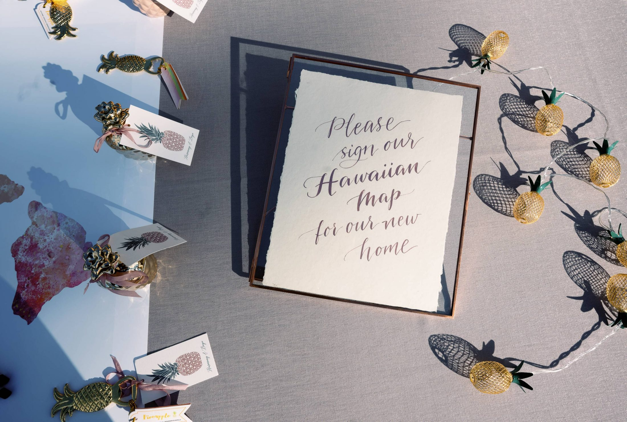 """Text: """"Please sign our Hawaiian map for our new home"""" - unique guestbook idea at Maui wedding at Four Seasons Resort Maui in Wailea, Hawaii 