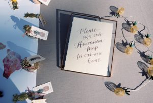 """Text: """"Please sign our Hawaiian map for our new home"""" - unique guestbook idea at Maui wedding at Four Seasons Resort Maui in Wailea, Hawaii   Photo by James x Schulze"""