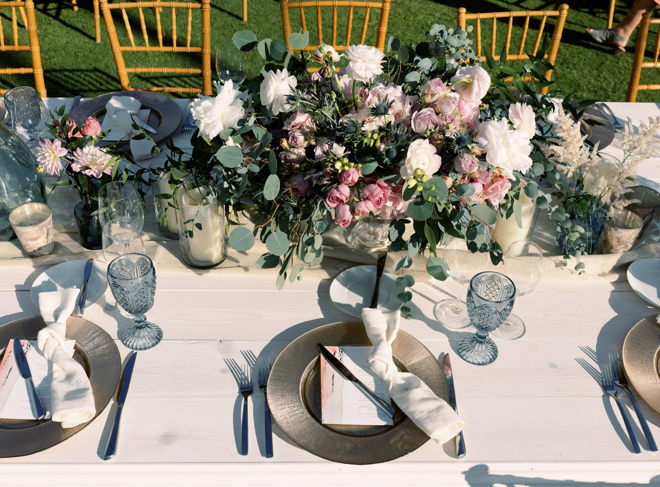 Table decor at outdoor reception at Maui wedding at Four Seasons Resort Maui in Wailea, Hawaii | Photo by James x Schulze