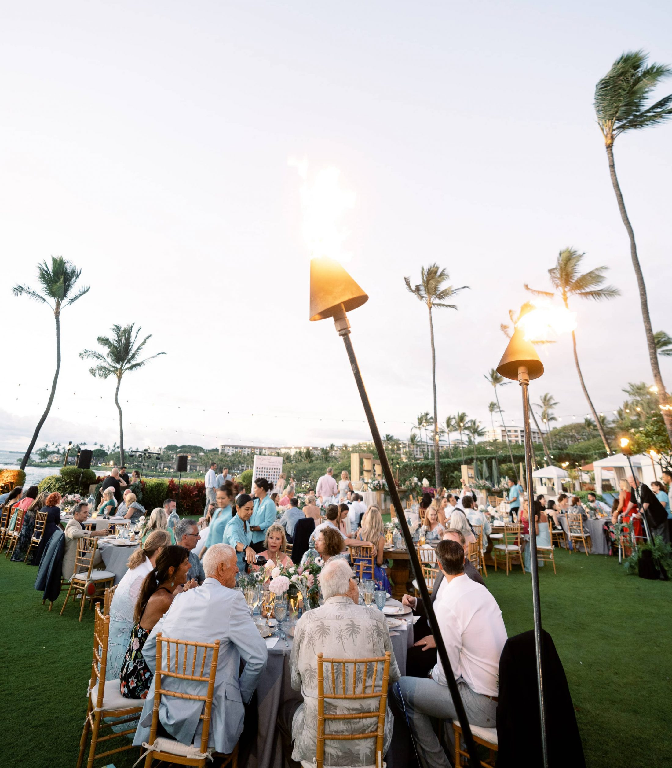 Outdoor reception at Maui wedding at Four Seasons Resort Maui in Wailea, Hawaii | Photo by James x Schulze