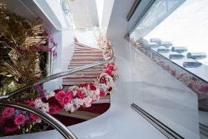 Floral decor lining the staircase at this Miami yacht wedding | Photo by Corbin Gurkin