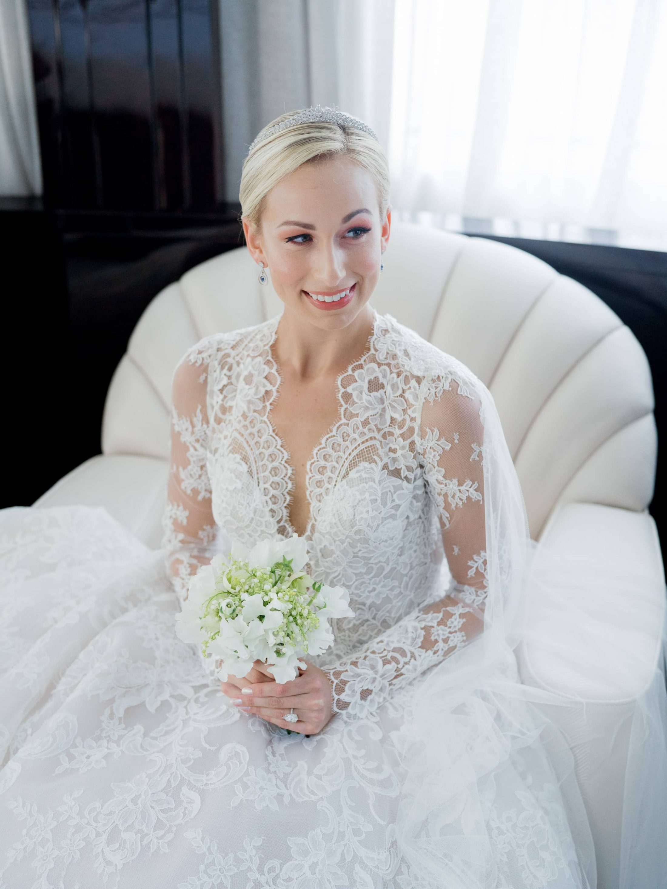 Bride in dress and with bouquet at this Miami yacht wedding | Photo by Corbin Gurkin
