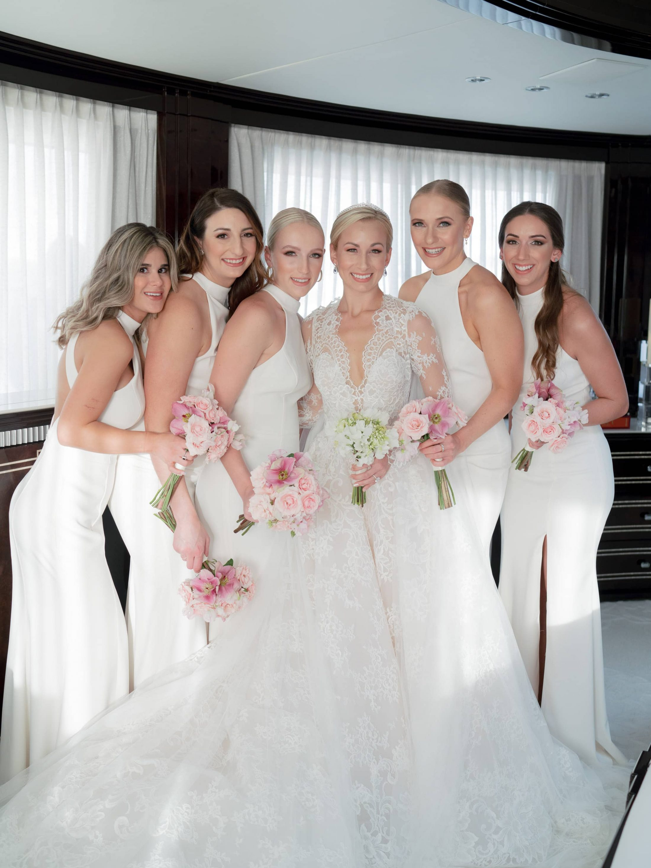 Bride with bridesmaids at this Miami yacht wedding | Photo by Corbin Gurkin