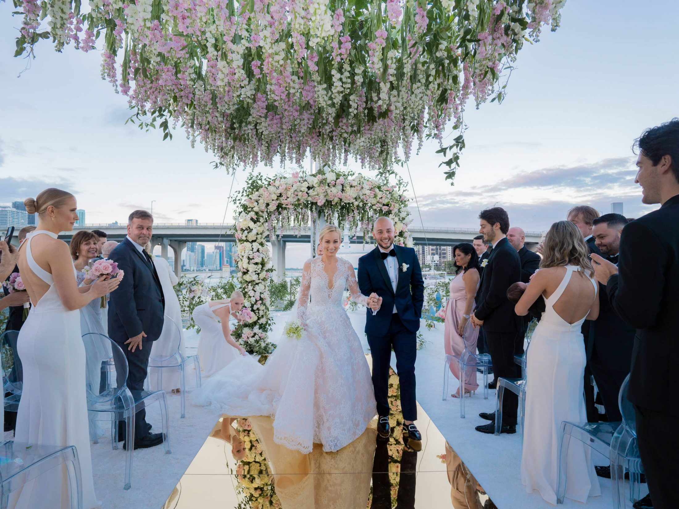 Newlyweds during ceremony at this Miami yacht wedding | Photo by Corbin Gurkin