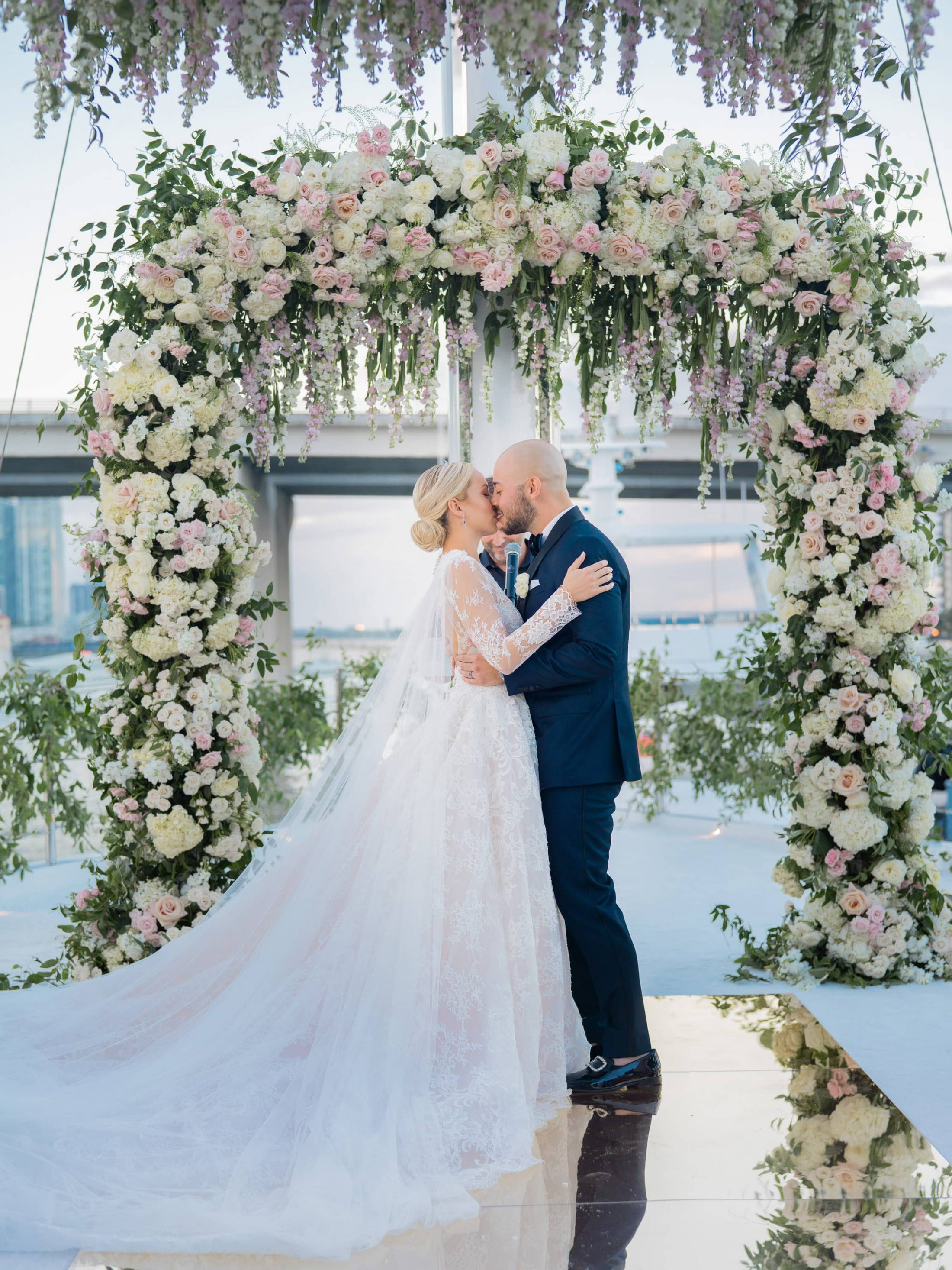 Bride and groom kiss at ceremony at this Miami yacht wedding | Photo by Corbin Gurkin