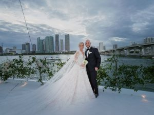 Bride and groom on the upper deck at this Miami yacht wedding | Photo by Corbin Gurkin