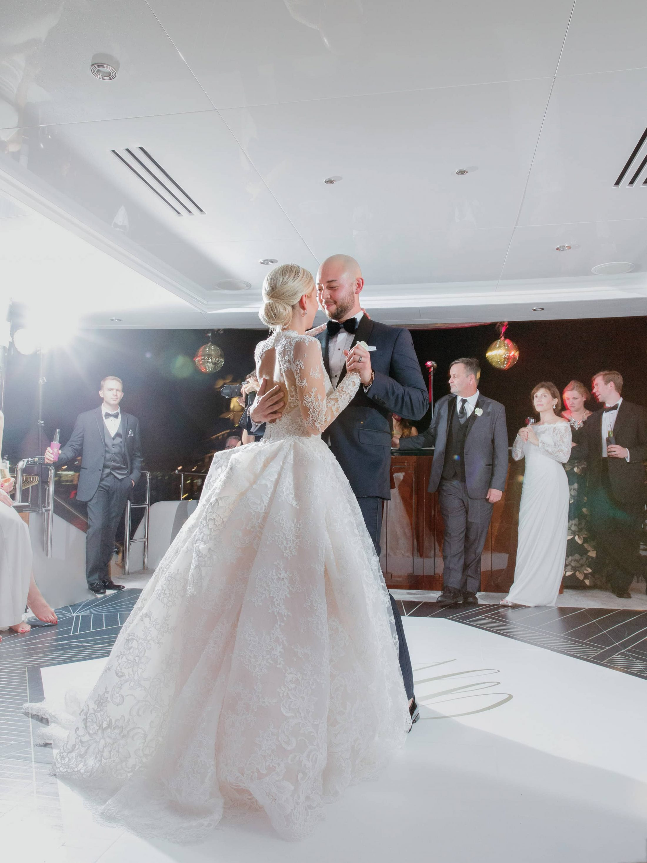 Bride and groom first dance during reception at this Miami yacht wedding | Photo by Corbin Gurkin