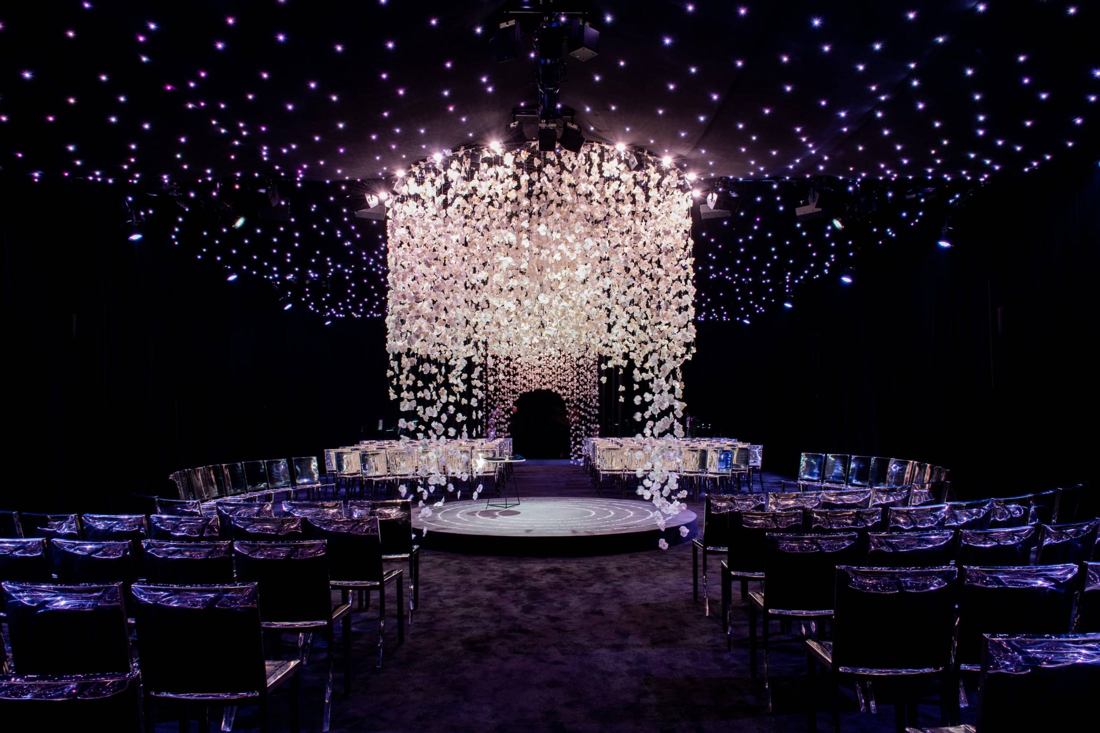 Chuppah made of hanging white orchids at this NYE wedding in New York City | Photo by Gruber Photo