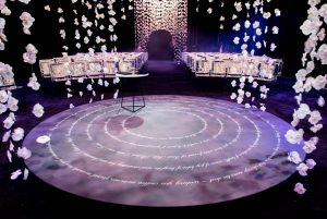 Ceremony with hanging white orchards wedding decor at this NYE wedding in New York City | Photo by Gruber Photo