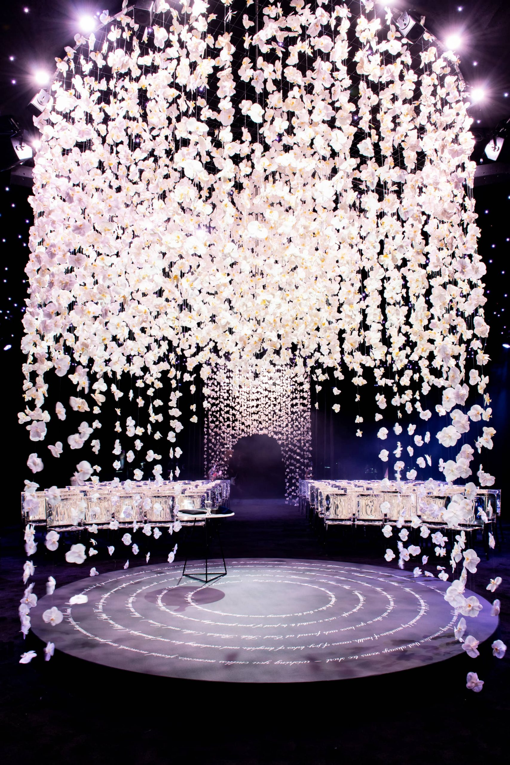 Chuppah made of hanging white orchards at this NYE wedding in New York City | Photo by Gruber Photo