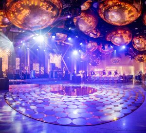 Dance floor at champagne bottle-inspired reception at this NYE wedding in New York City | Photo by Gruber Photo