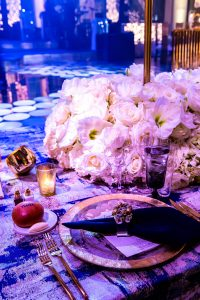 Table decor at champagne bottle-inspired reception at this NYE wedding in New York City | Photo by Gruber Photo