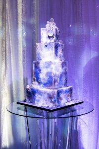 4-tier square wedding cake at champagne bottle-inspired reception at this NYE wedding in New York City   Photo by Gruber Photo