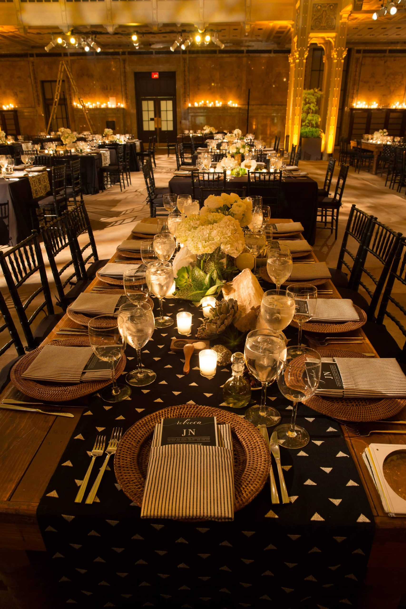 Black, white, and gold table decor for reception at this New York Public Library wedding | Photo by Genevieve de Manio