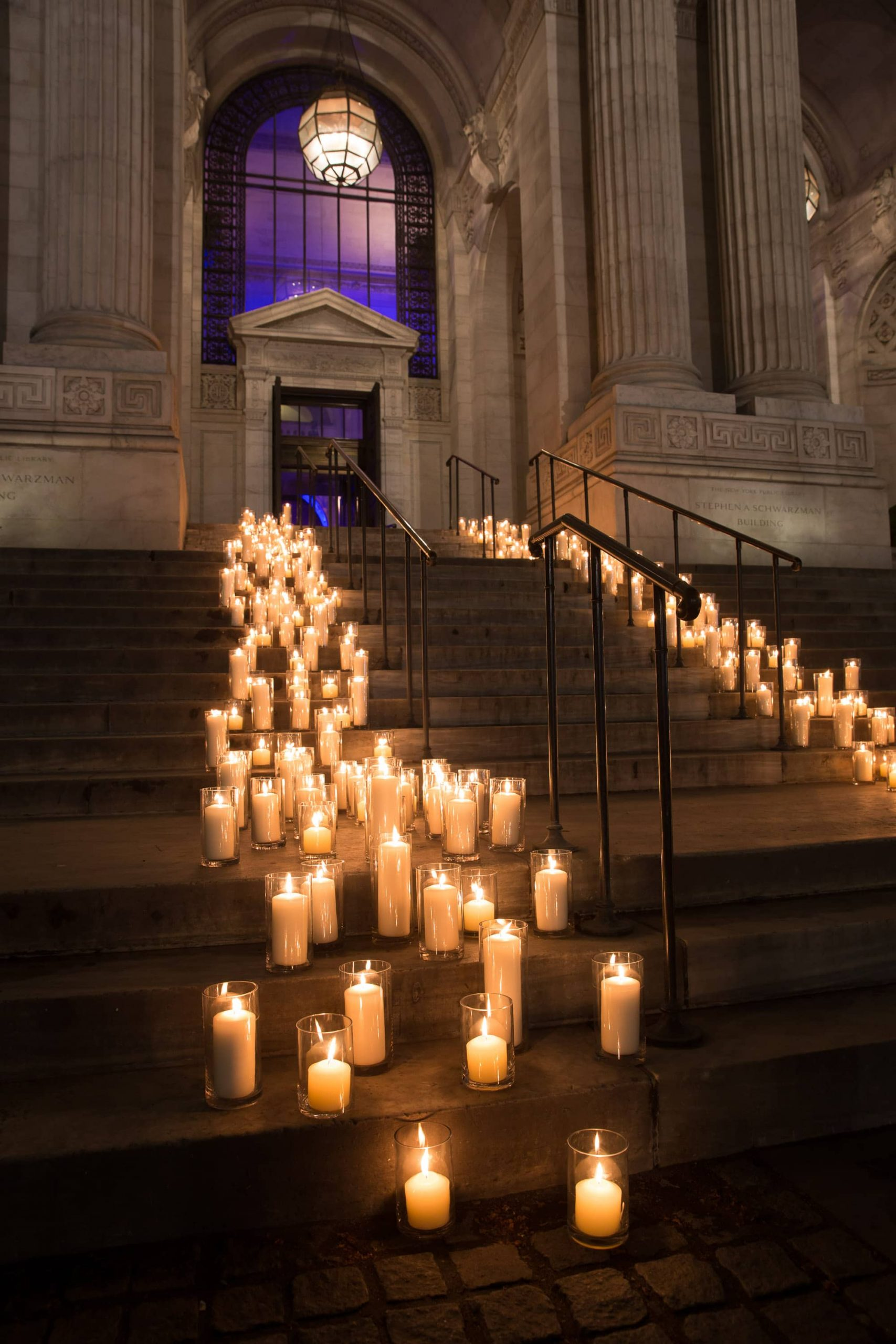Candle-strewn stairway at this New York Public Library wedding | Photo by Genevieve de Manio