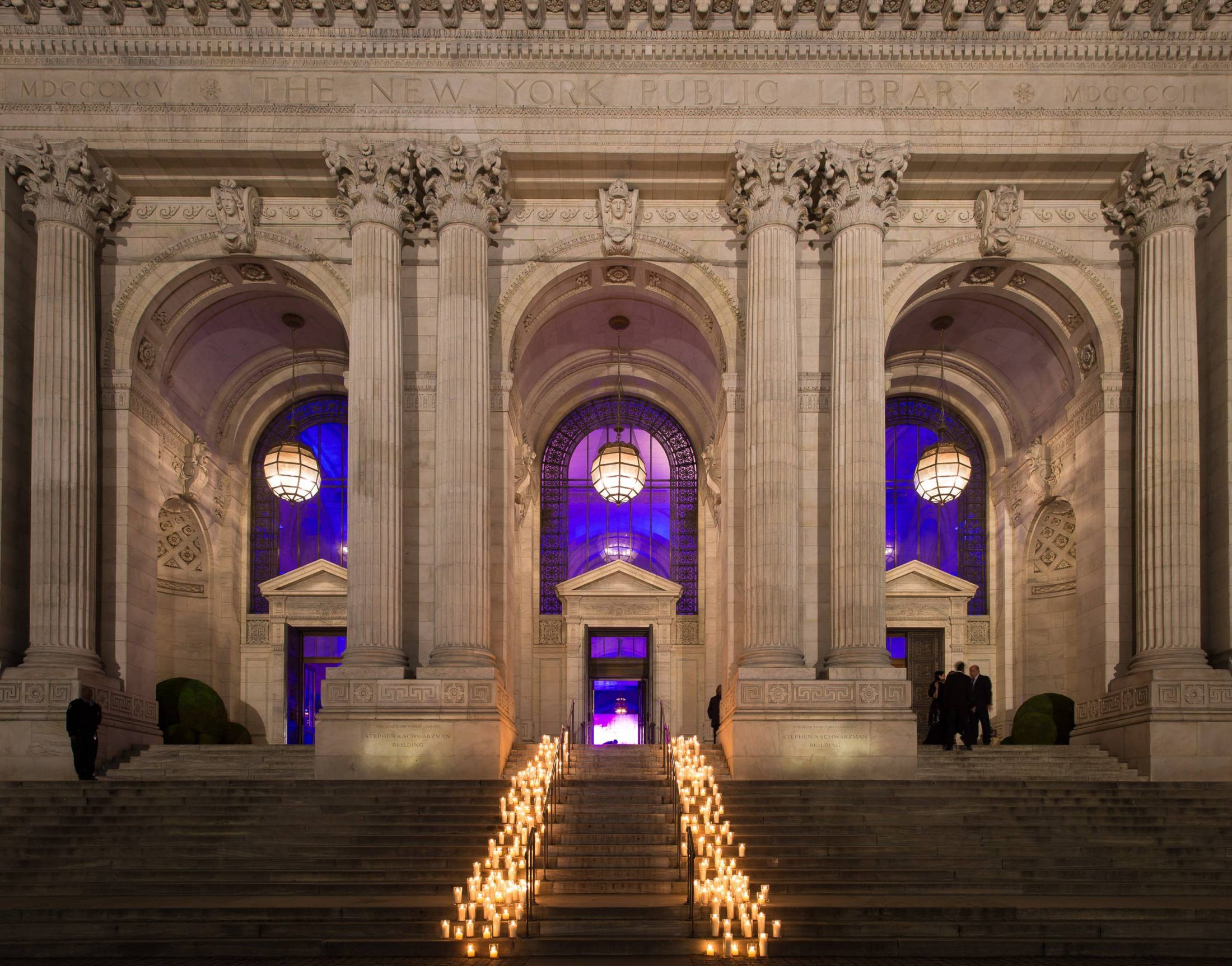 Candle-strewn pathway into the library at this New York Public Library wedding | Photo by Genevieve de Manio