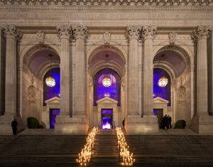Candle-strewn pathway into the library at this New York Public Library wedding   Photo by Genevieve de Manio