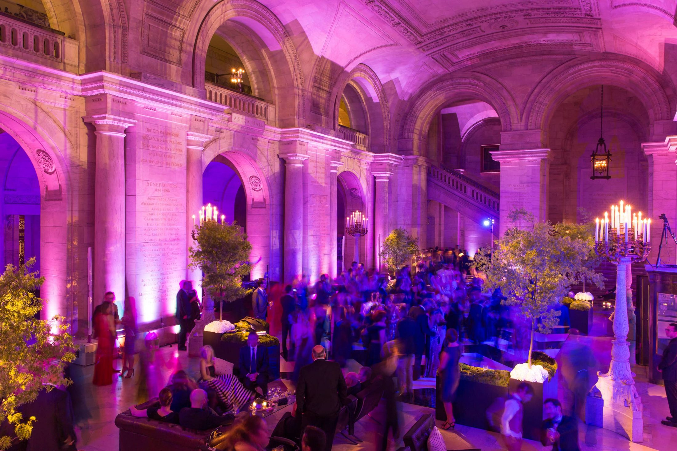 Guests during pink-hued reception at this New York Public Library wedding | Photo by Genevieve de Manio