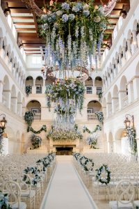 Cascading blue flowers at The Cloister ceremony at this Sea Island wedding weekend in Georgia, USA   Photo by Liz Banfield