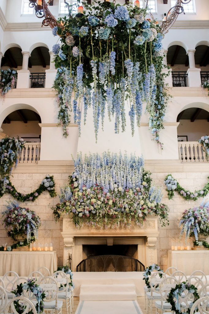 Cascading blue flowers at The Cloister ceremony at this Sea Island wedding weekend in Georgia, USA | Photo by Liz Banfield