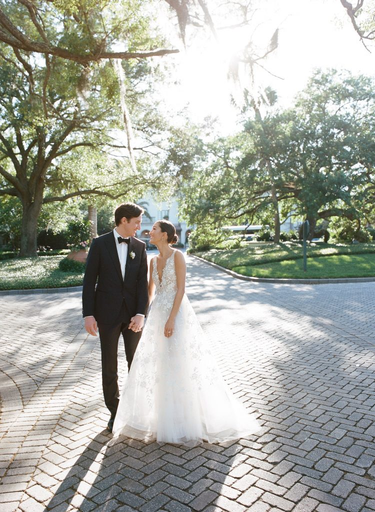 Wedding couple at this Sea Island wedding weekend in Georgia, USA | Photo by Liz Banfield