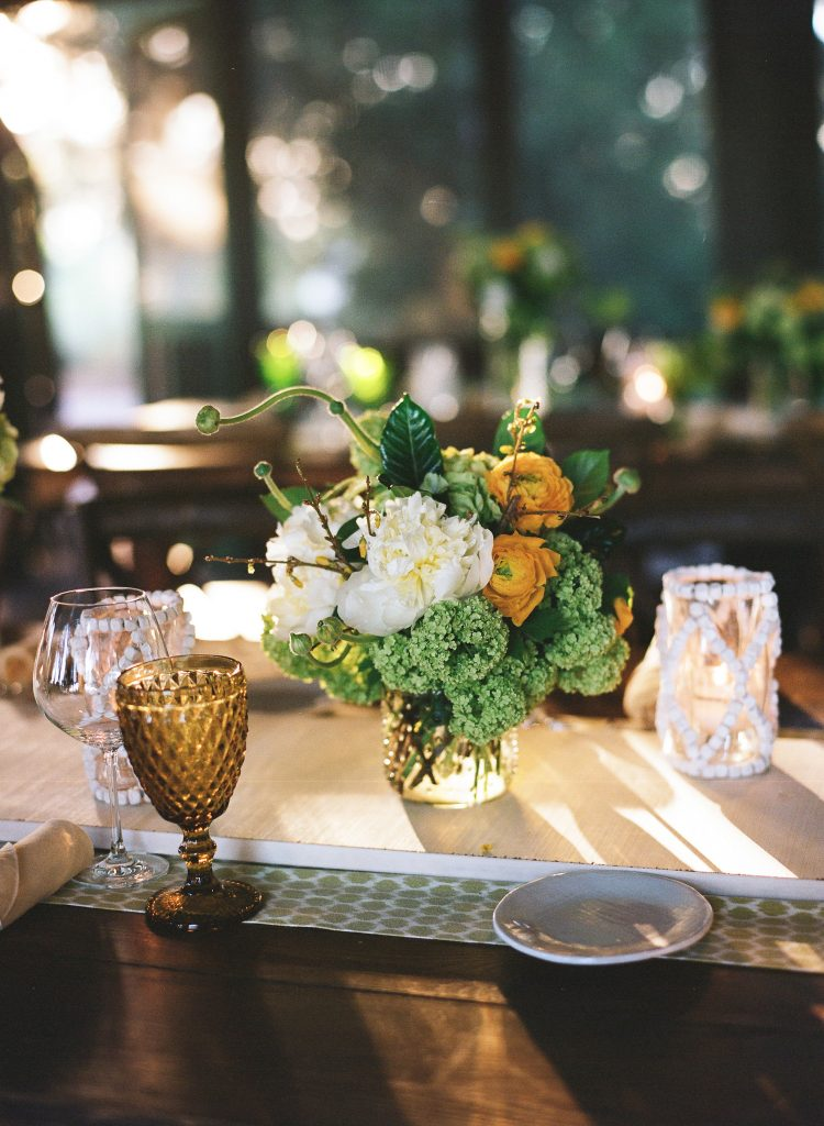 Table decor at BBQ welcome party at this Sea Island wedding weekend in Georgia, USA | Photo by Liz Banfield