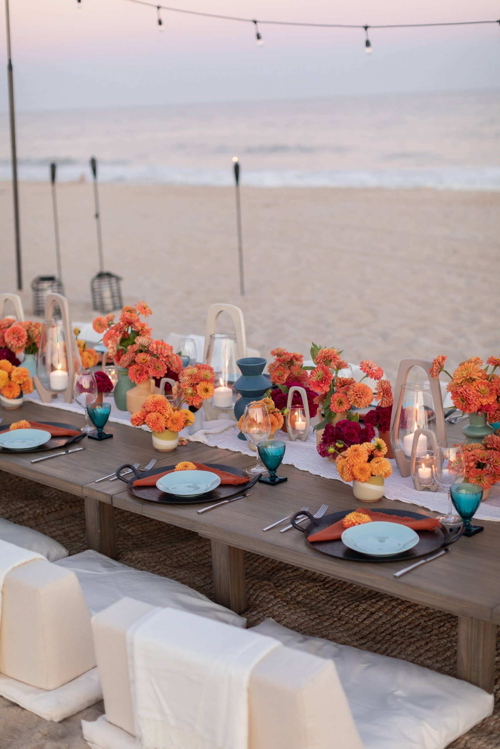 Table decor at 40th birthday dinner on the beach in Southampton | Photo by Luis Zepeda