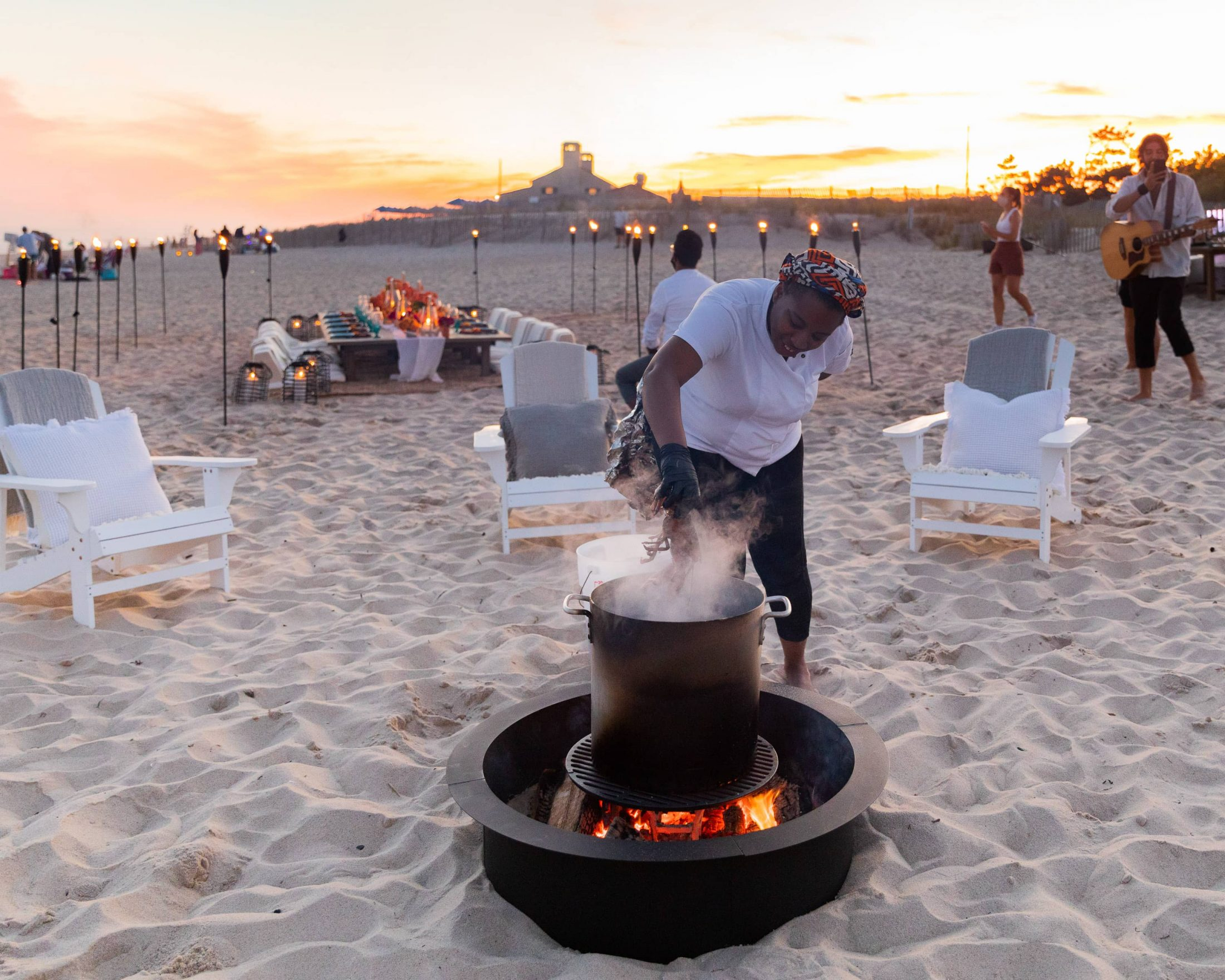 Fire pit at 40th birthday dinner on the beach in Southampton | Photo by Luis Zepeda