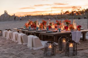Table set-up at 40th birthday dinner on the beach in Southampton | Photo by Luis Zepeda